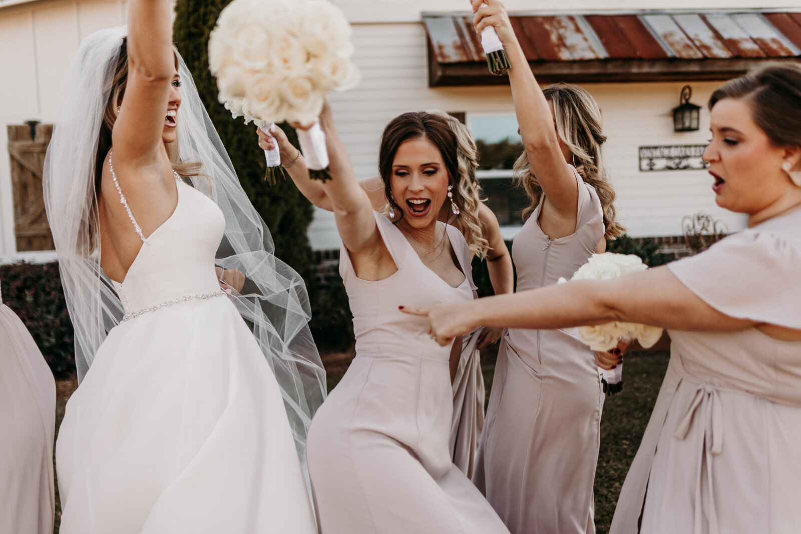 J.Michelle Photography photographs bridesmaids dance at vintage oaks farm wedding in Athens, Ga
