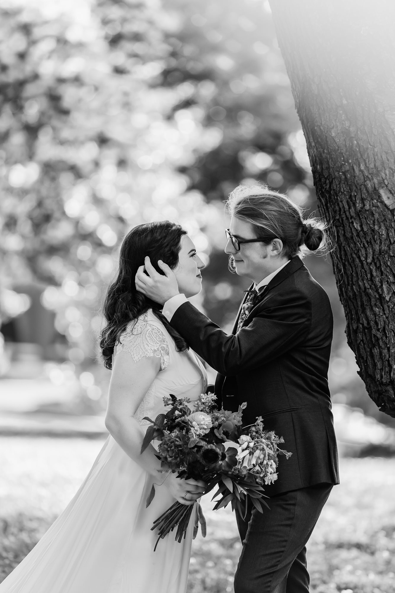 Black and white photo of bride and groom together in Tower Grove Park in St. Louis