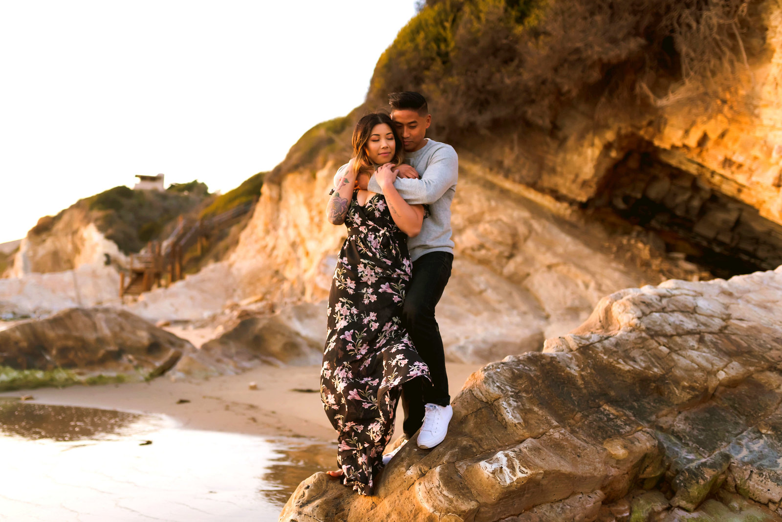 Engagement photo of a couple on a cliff in Santa Barbara, California