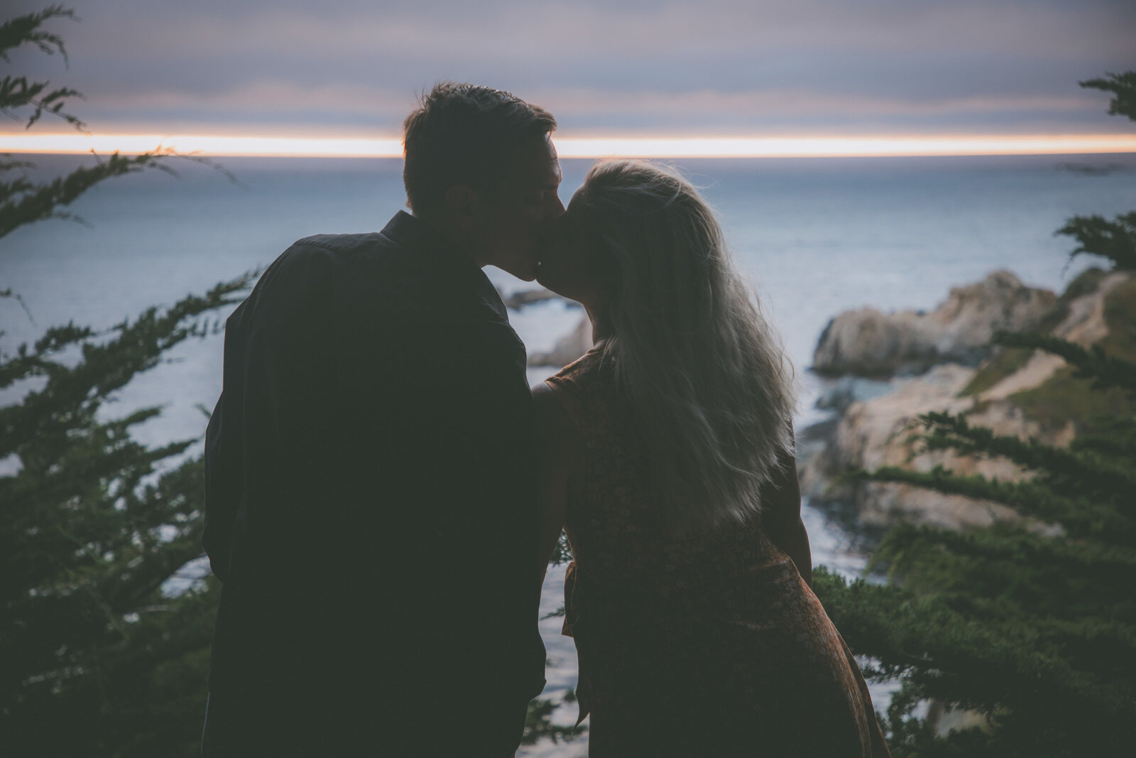 A silhouette of a couple's kiss in Big Sur.