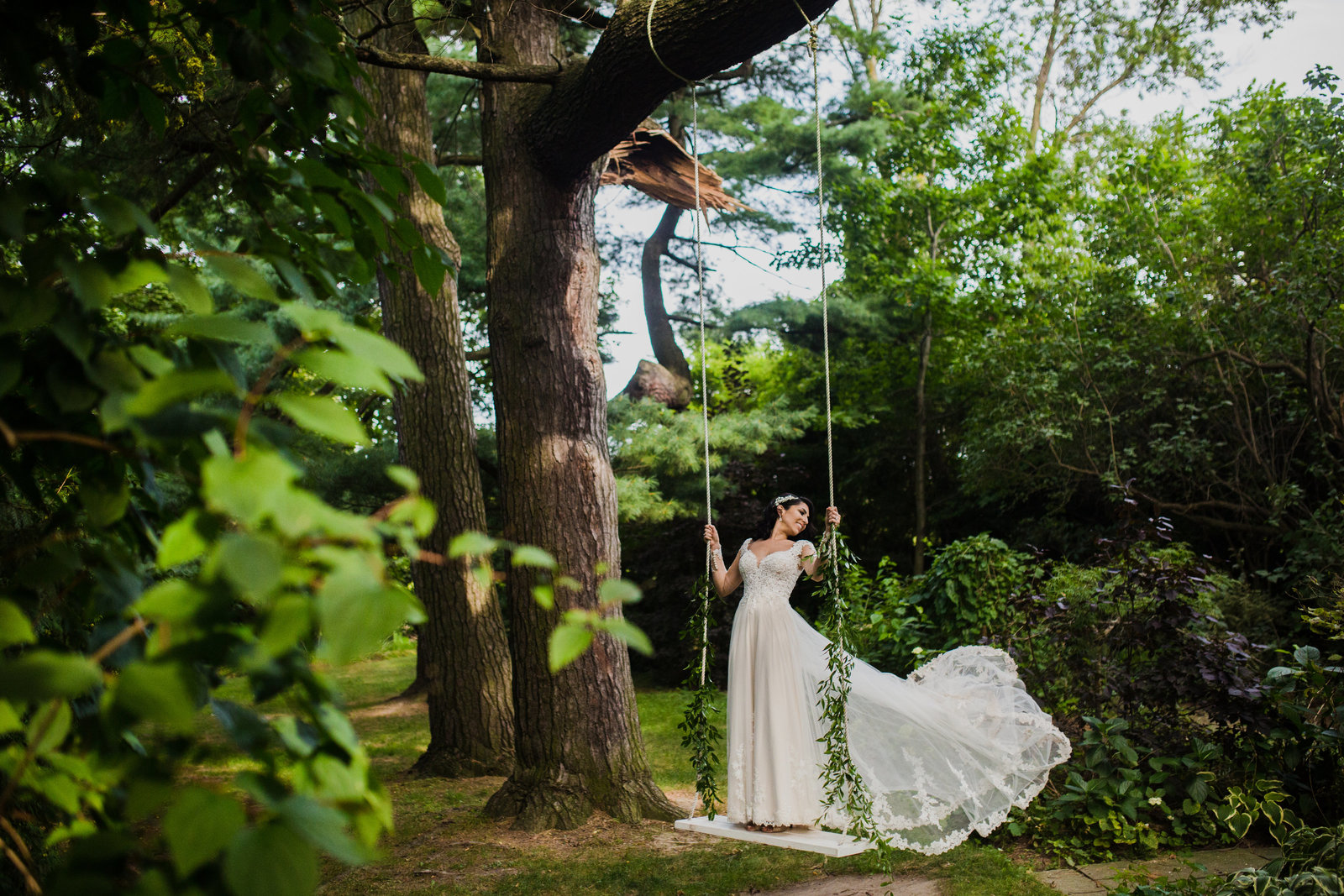 7 Bride on wedding day on swing