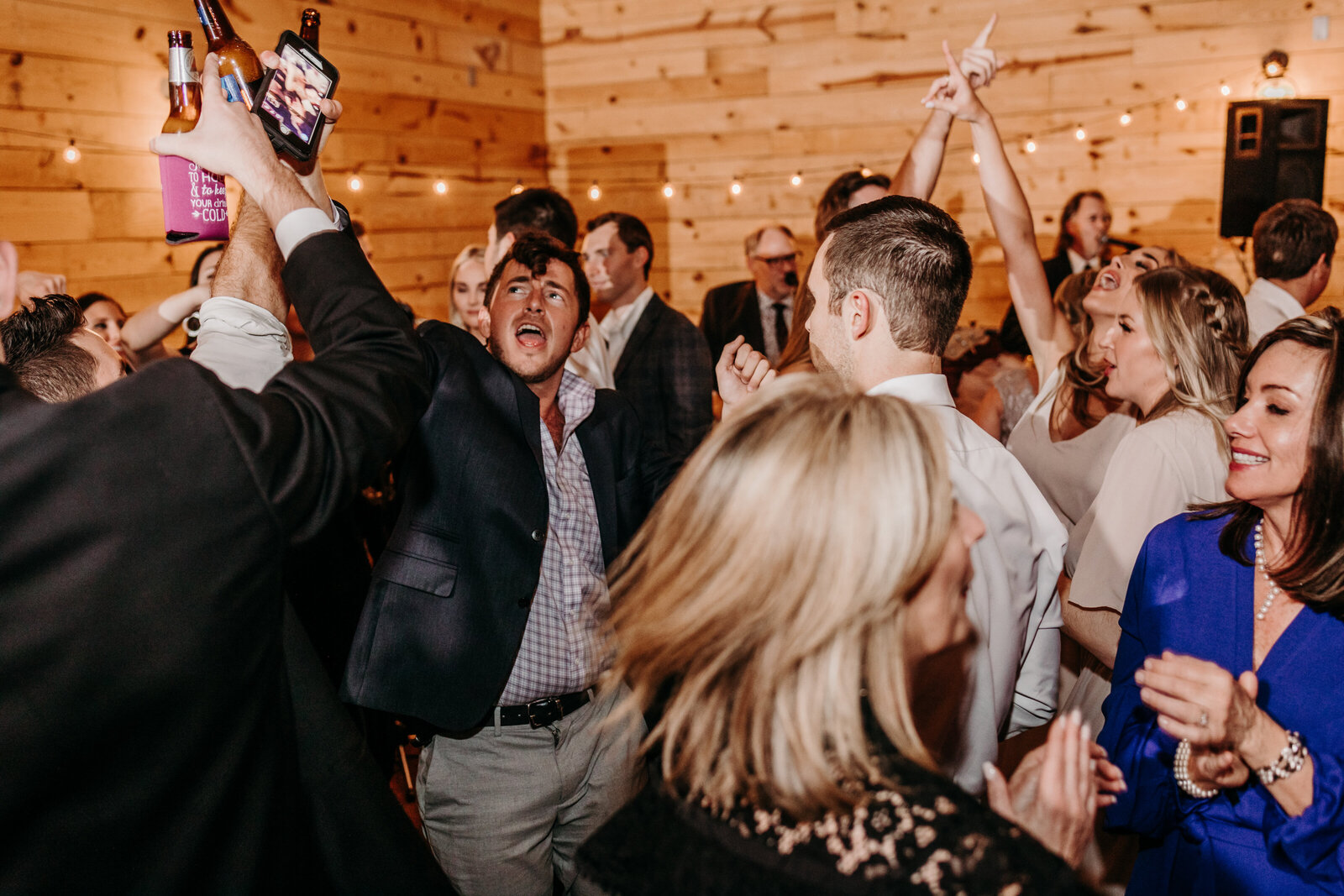 J.Michelle Photography photographs guests dancing at a reception at vintage oaks farm wedding in Athens, Ga