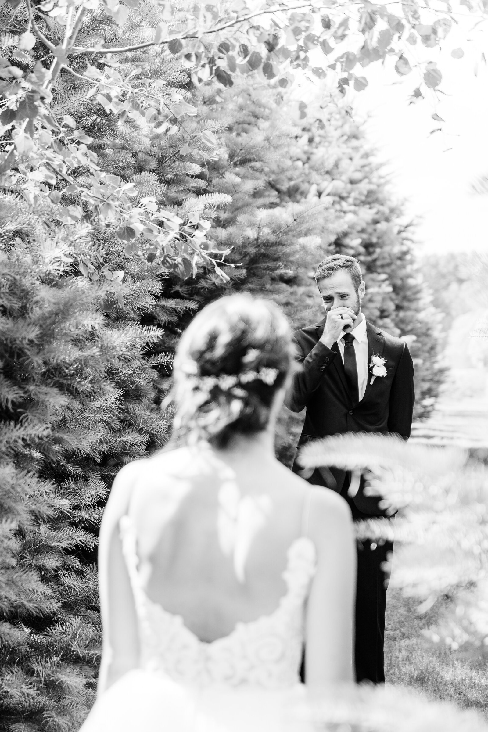 Grooms-has-the-most-emotional-reaction-during-first-look-with-his-future-wife-between-the-pines-at-arrowwood-farms-in-melbourne-ontario