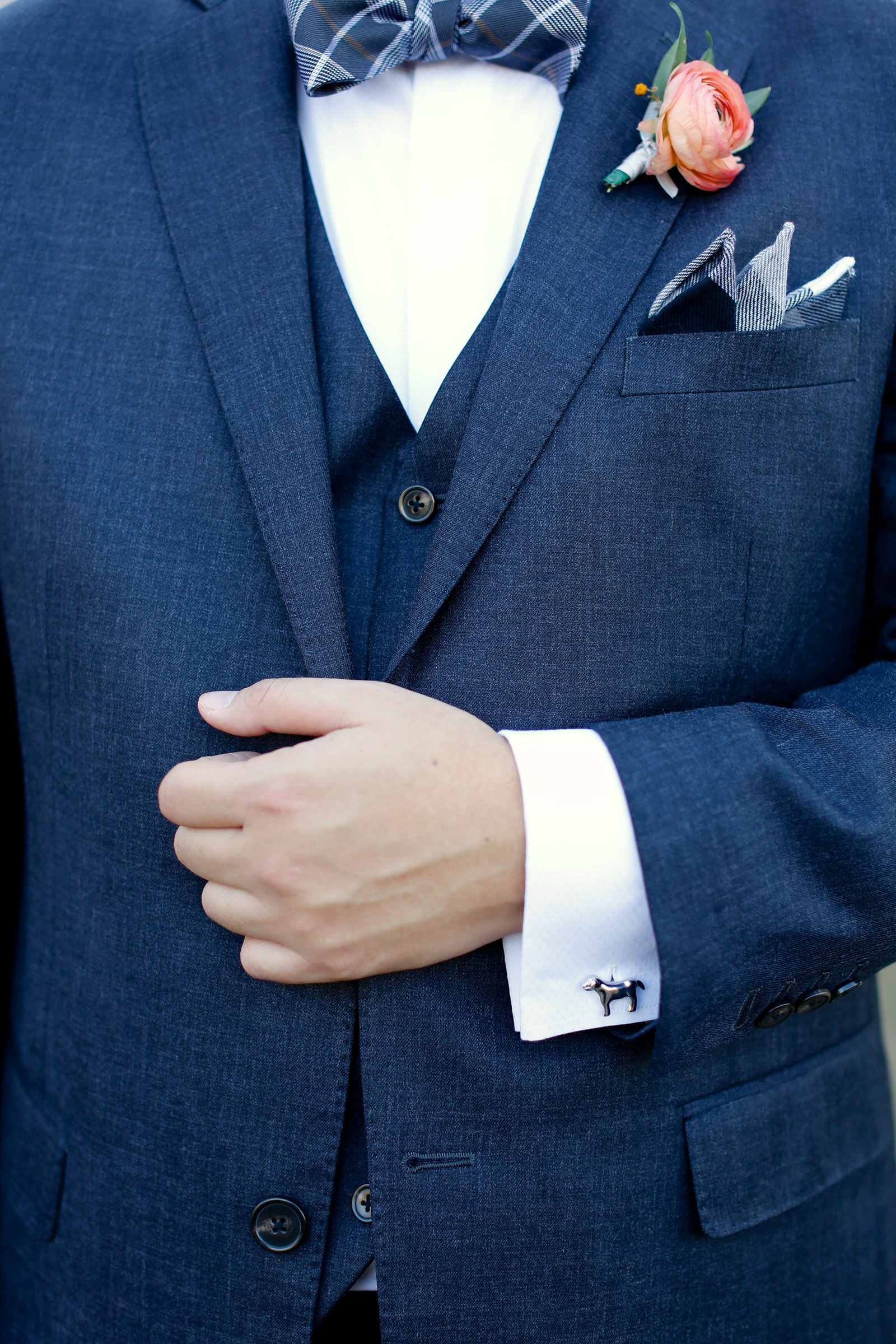 dog cufflink and patterned bowtie on groom