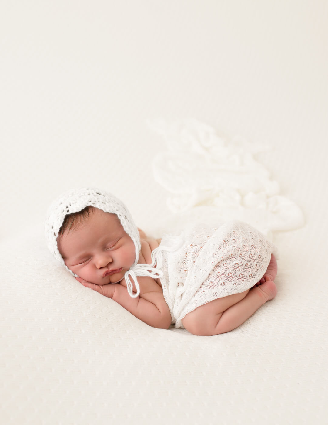 Beautiful sleepy newborn girl in bum up pose in Rochester, NY