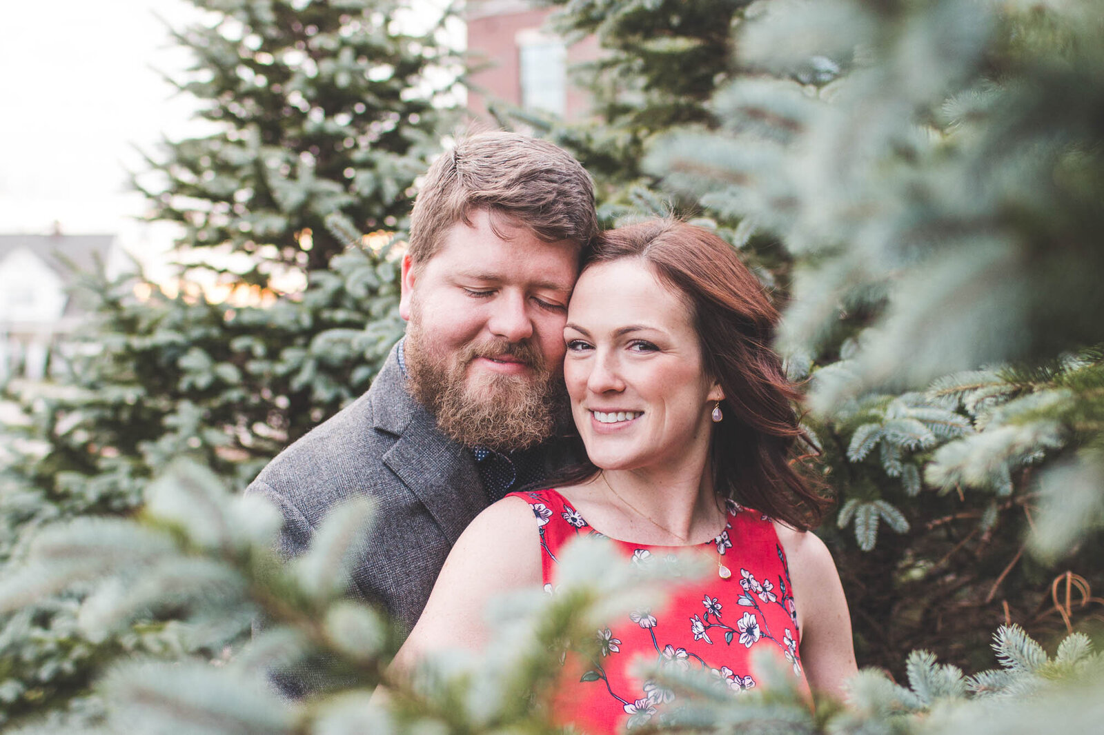 engagement-photography-couple-through-fur-trees