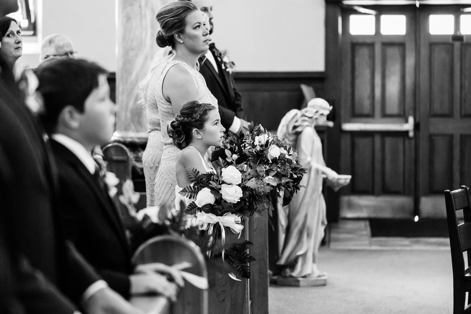 Flowergirl-admiring-the-wedding-couple-during-their-church-ceremony