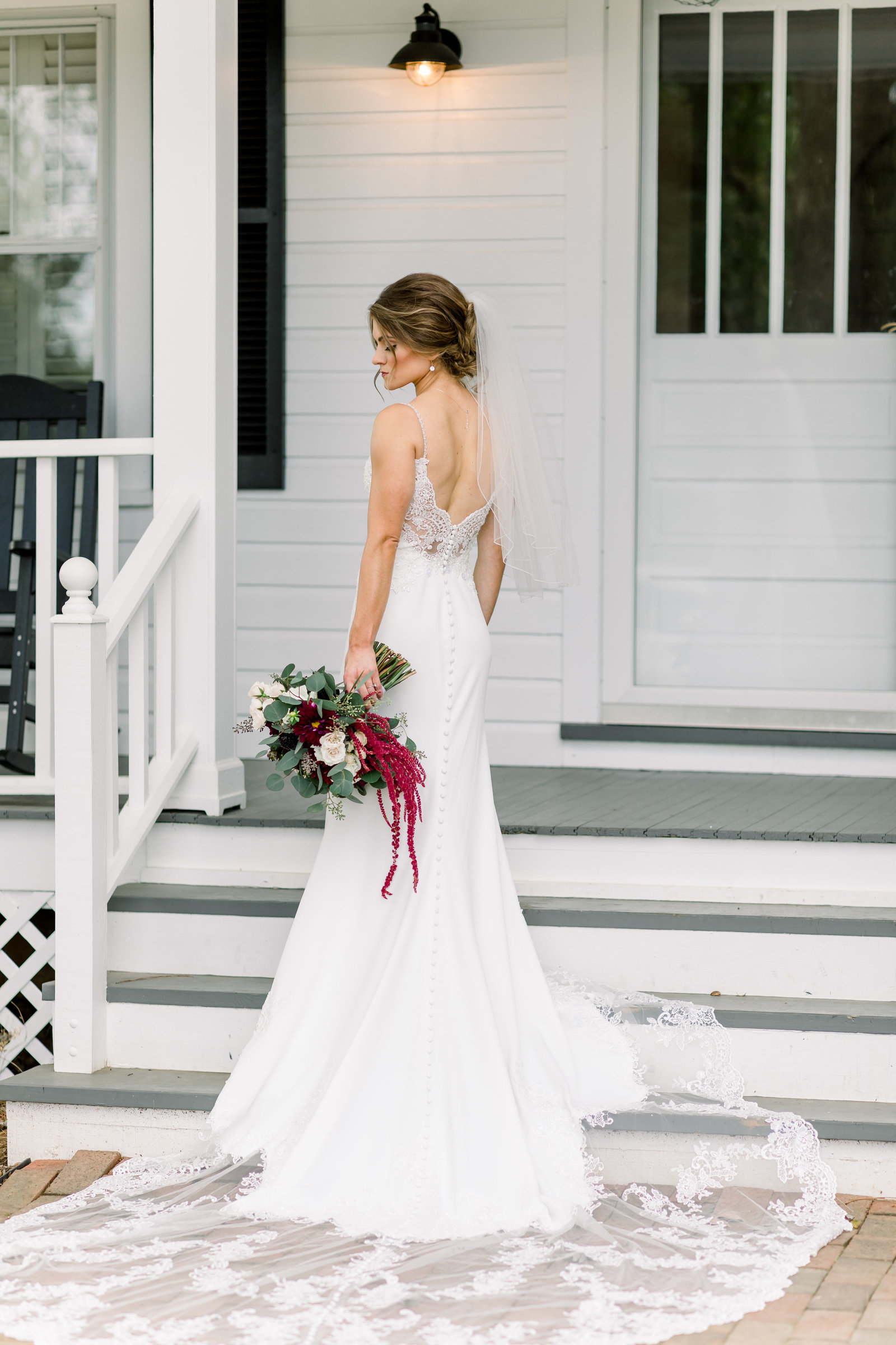 Washington DC Wedding Photography, bride holding her bouquet and standing on steps