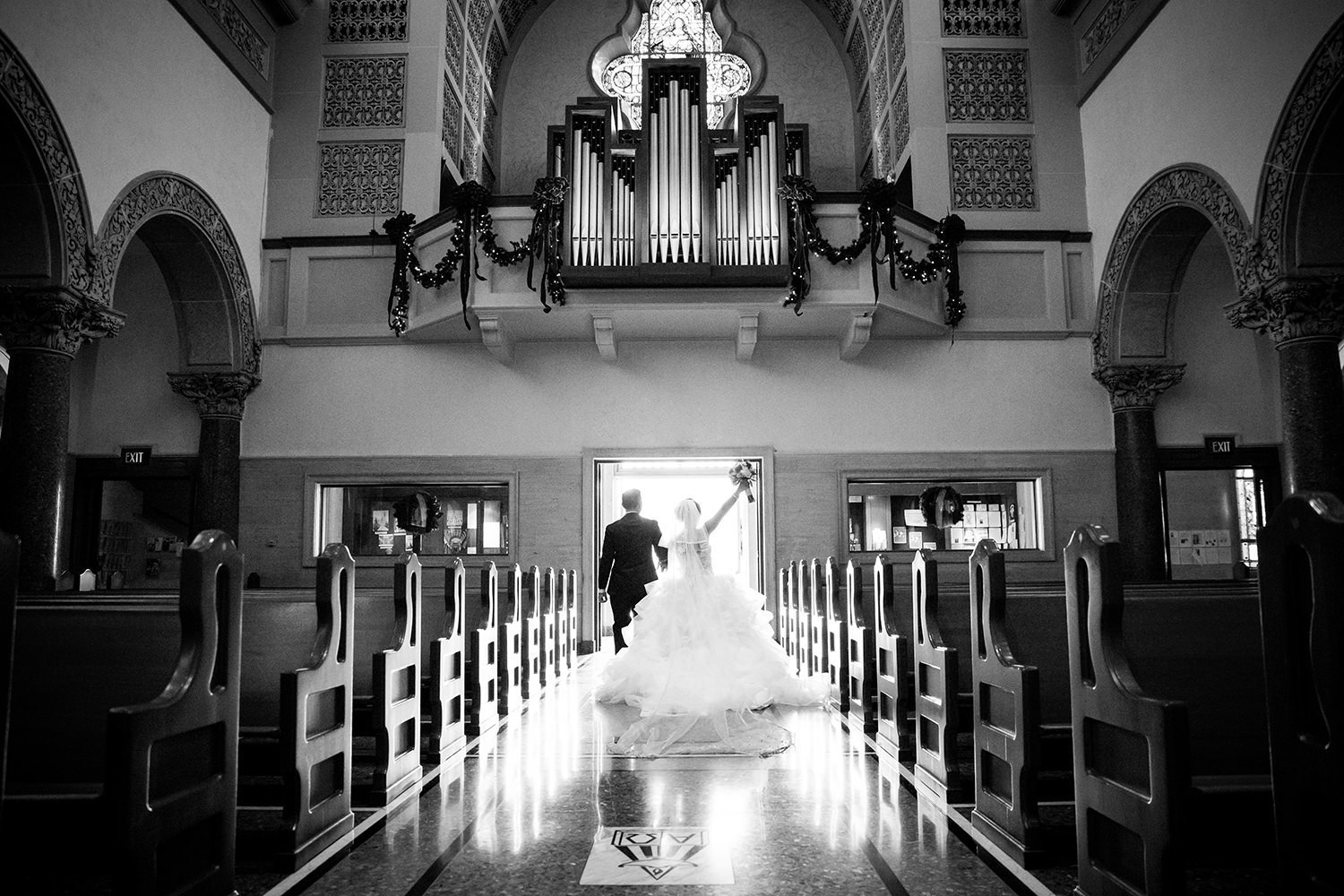 couple walking out of the immaculata of their i do's