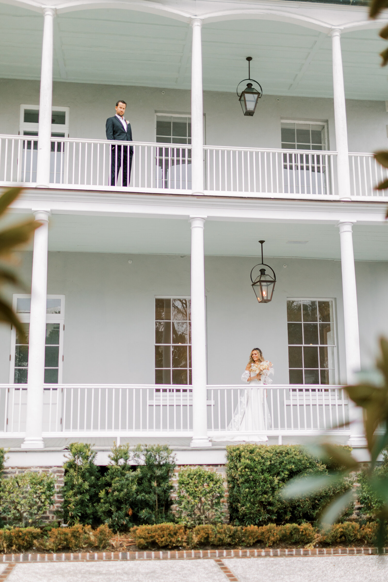 bride on lower level of the patio and groom on the upper level of the patio at the gadsden house in charleston south carolina