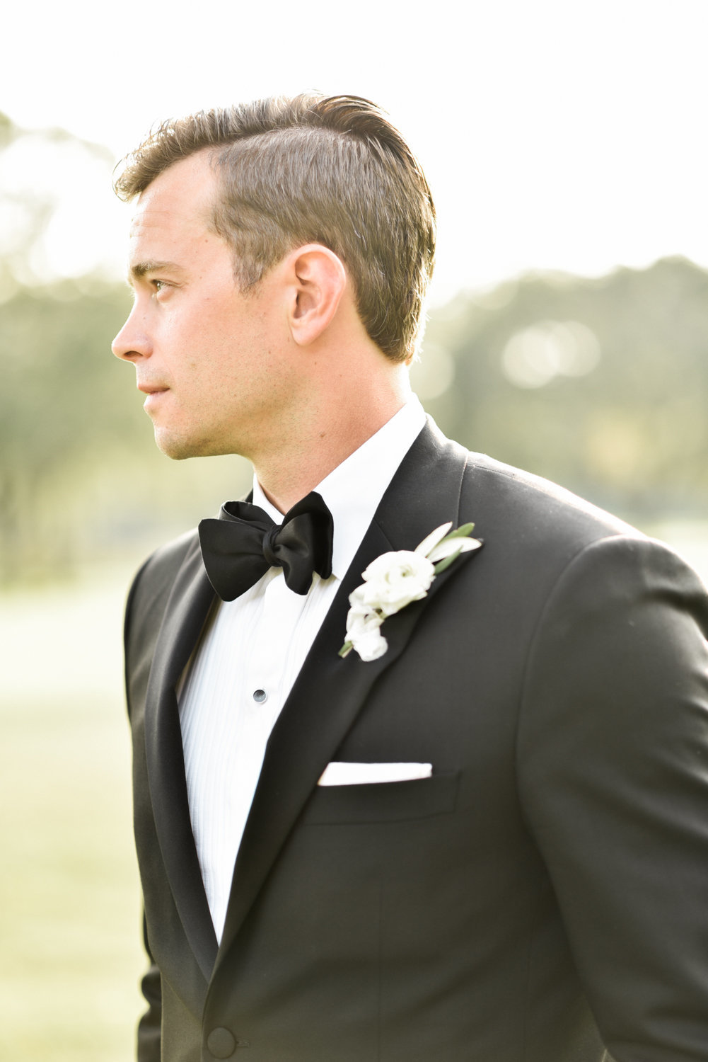 groom black suit
