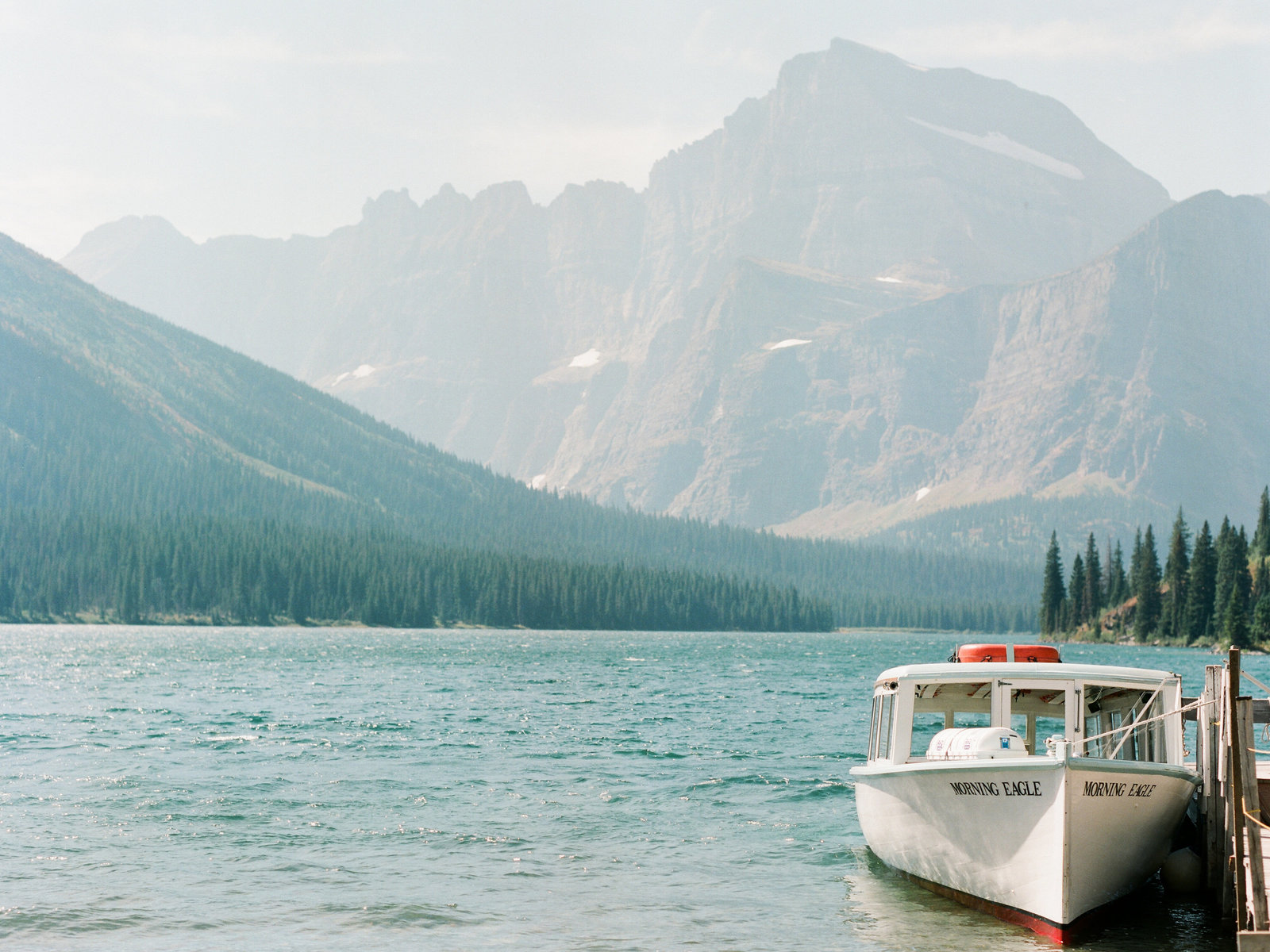 glacier-national-park-boat-in-lake-photo