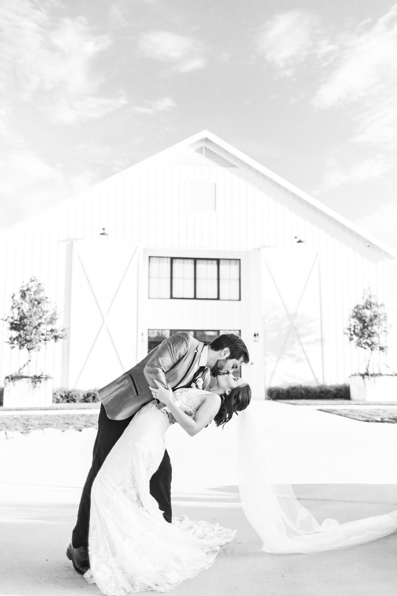 An Outdoor Black and White Couples' Portrait at The Farmhouse