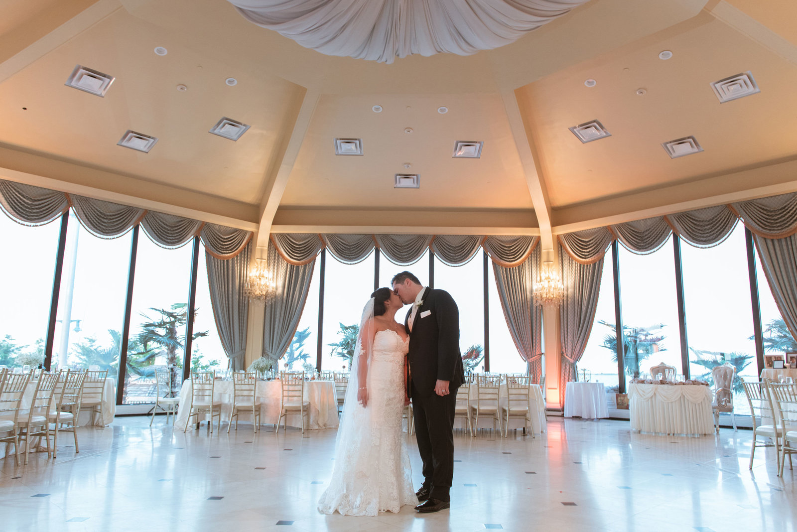 Bride and groom in the ballroom at Chateau La Mer