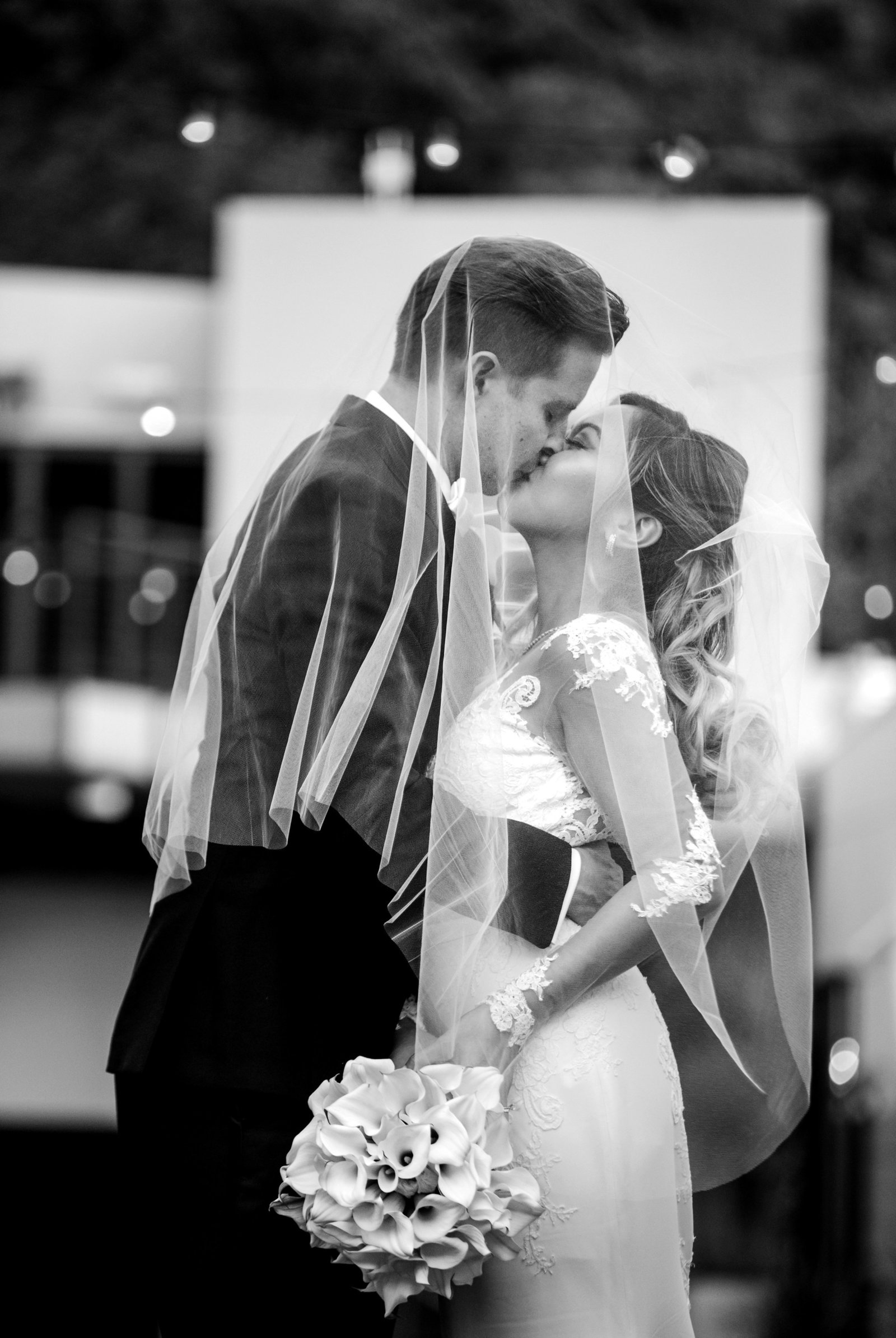 black and white photo of bride and groom kissing  in laguna beach seven degrees wedding