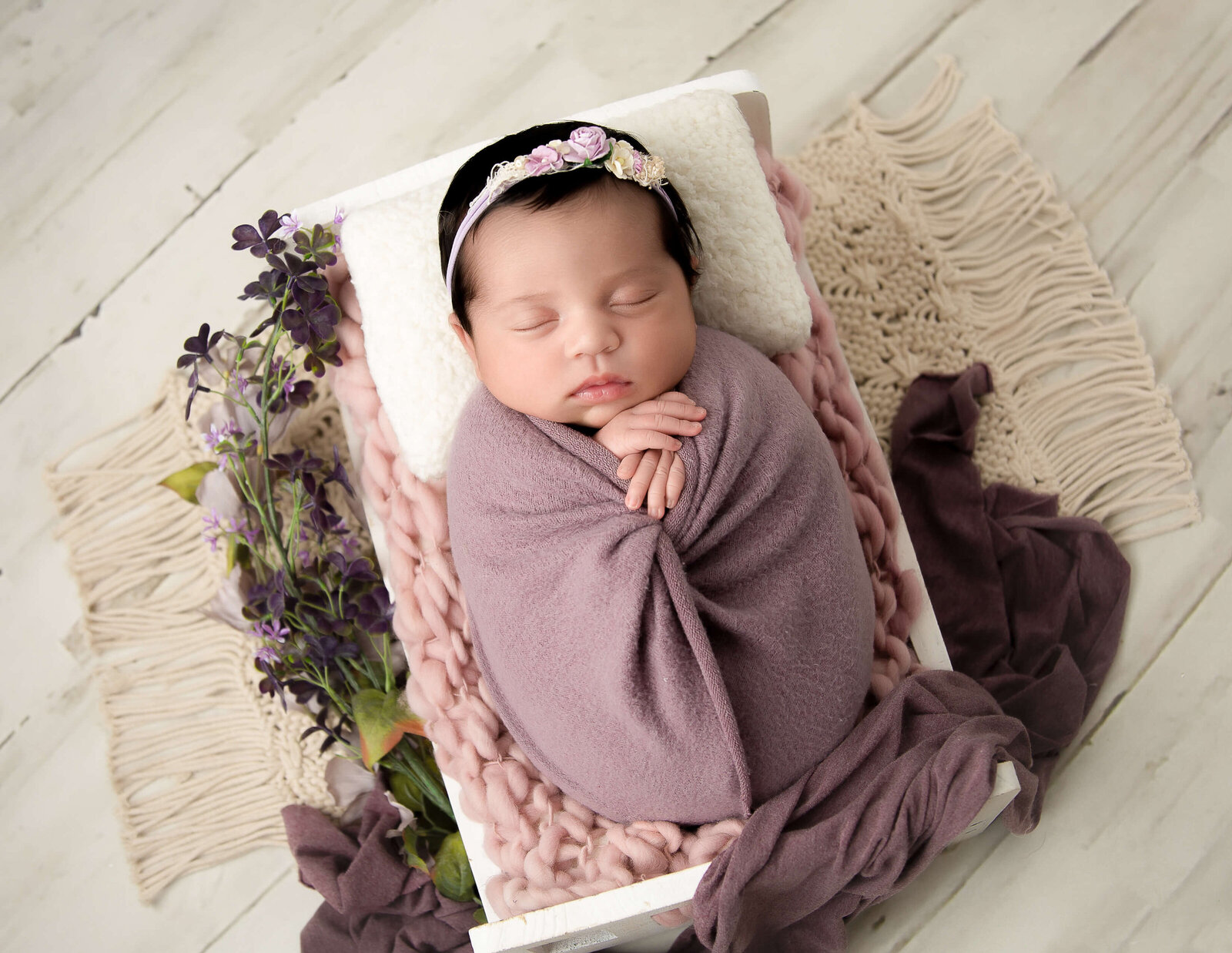 Posed sweet newborn girl at our in-home Rochester, Ny studio.