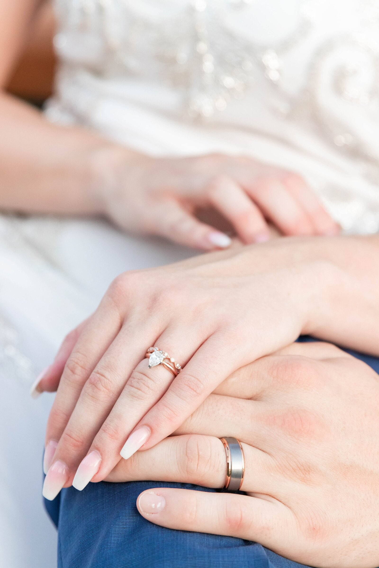 bride-and-groom-hands-with-wedding-rings