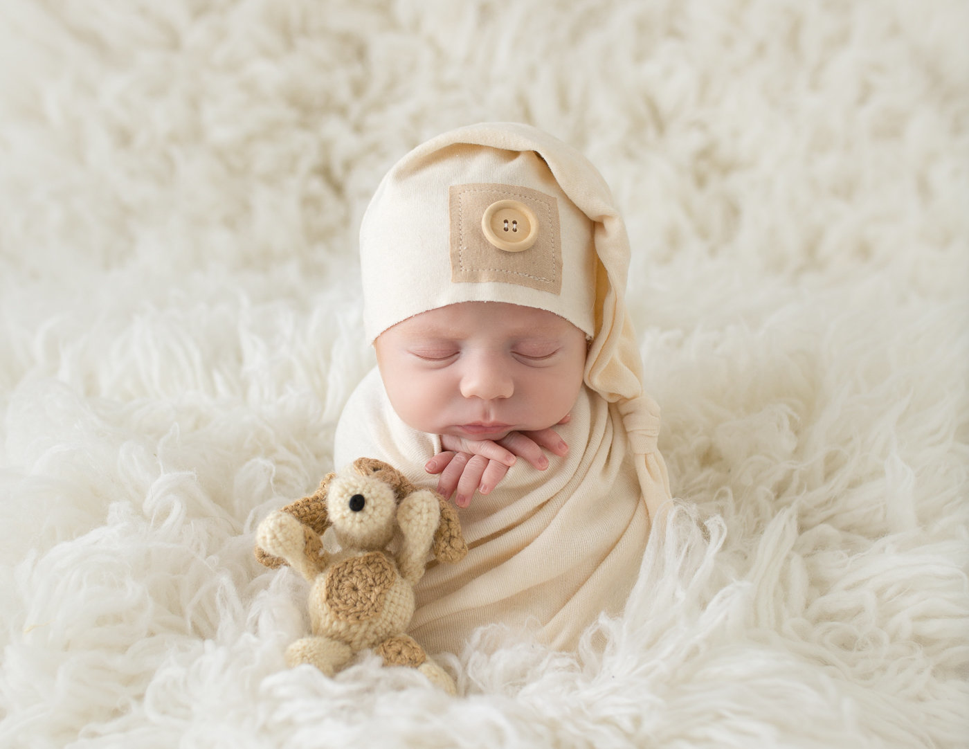 Sweet newborn boy posed in our Rochester, Ny studio.