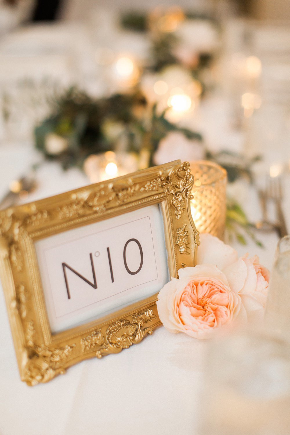 Modern wedding table numbers in gold frames at Belle Mer in Newport, RI