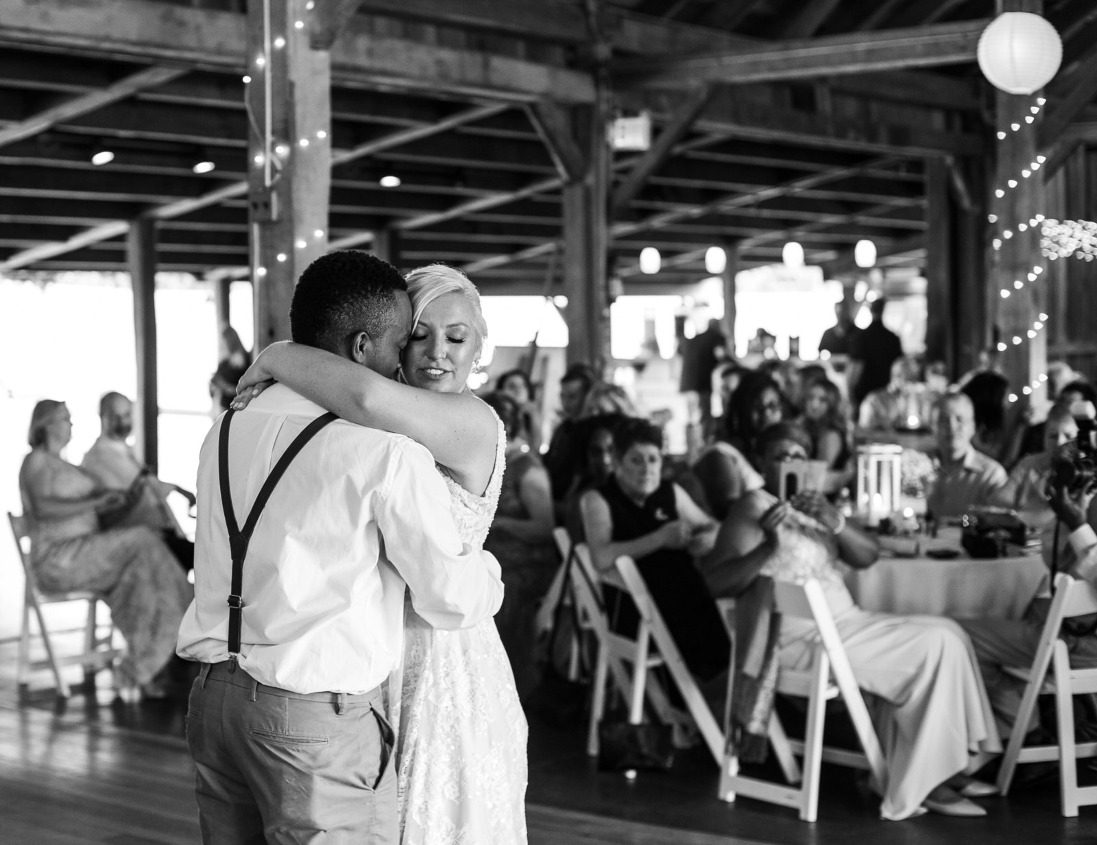 Bride and groom embrace during first dance at Betsy's Barn wedding