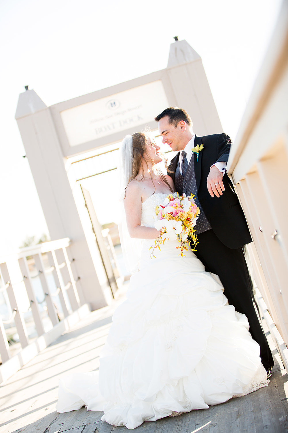 bride and groom on dock at hilton mission bay