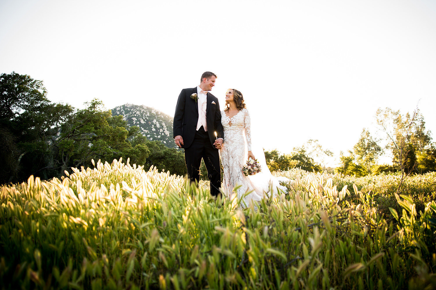 open field with bride and groom