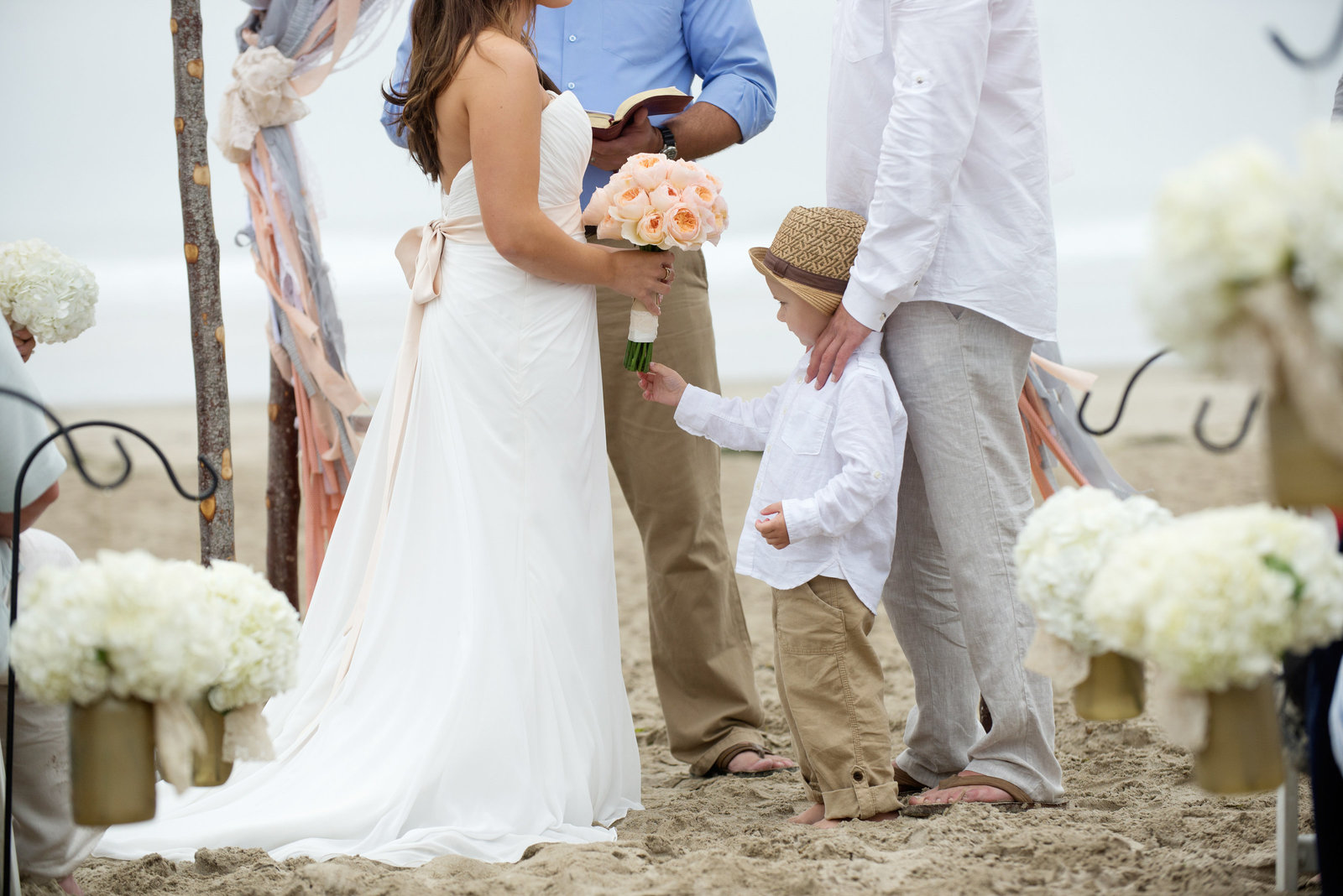 ring bearer stands at front with bride and groom during ceremony
