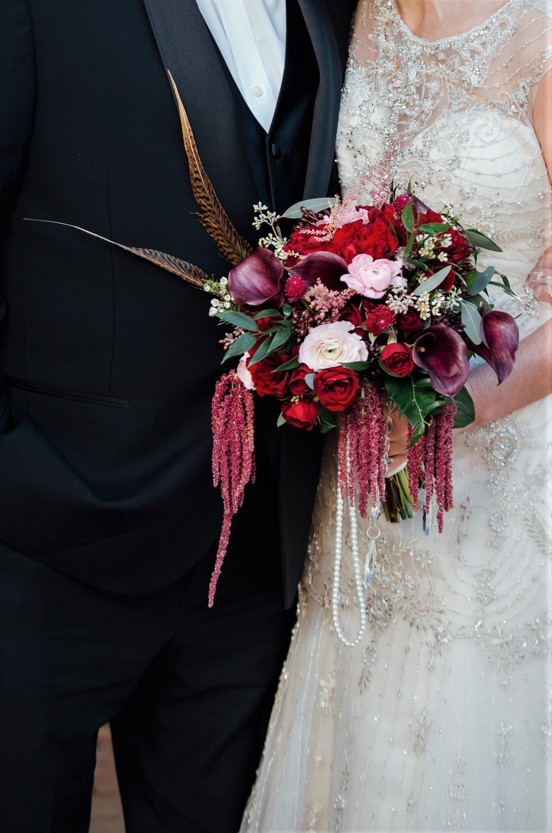 Bridal bouquet with pearls, crystals, and feathers