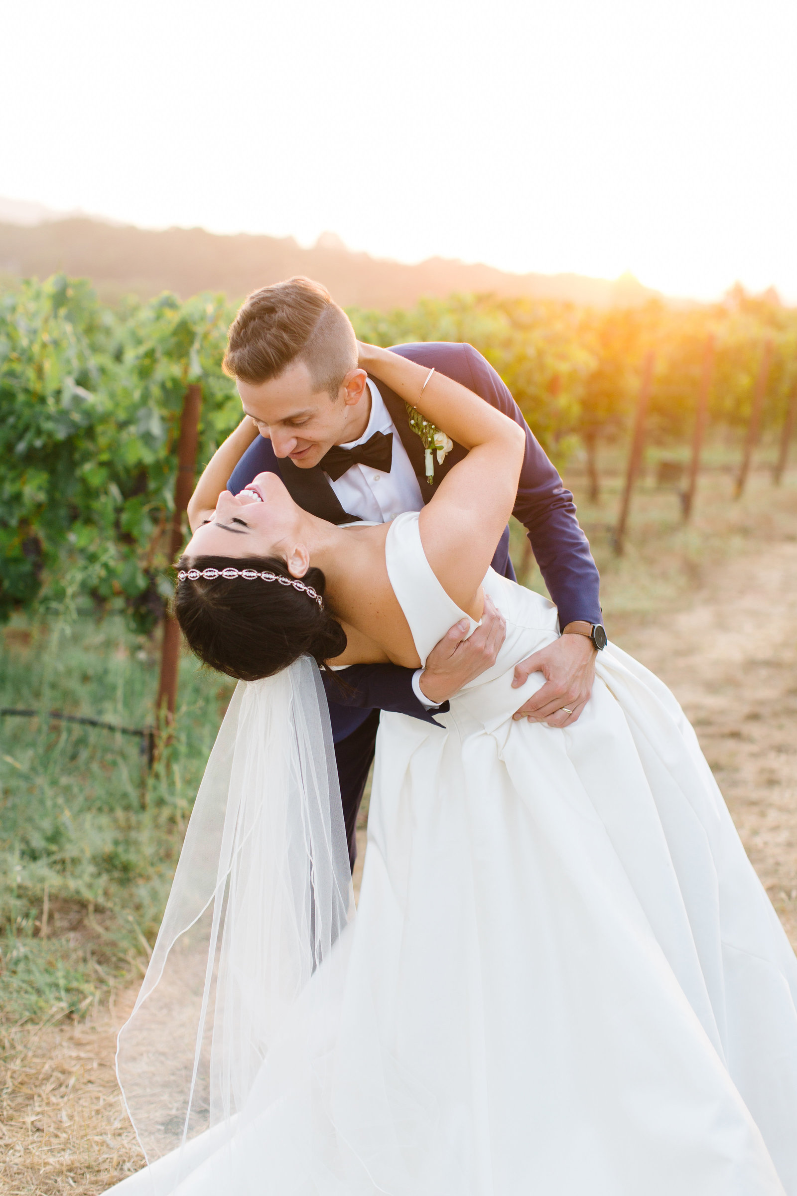 bride and groom in the vineyards at sunset at Annadel Estate Winery in Santa Rosa California