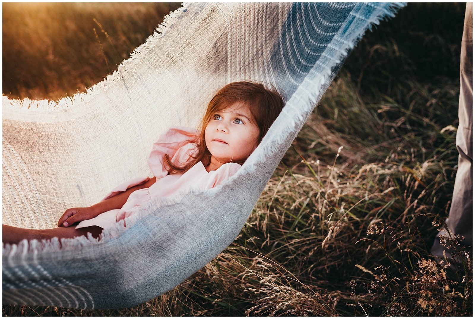 Little girl swining in blanket in field at sunset Emily Ann Photography Seattle Photographer