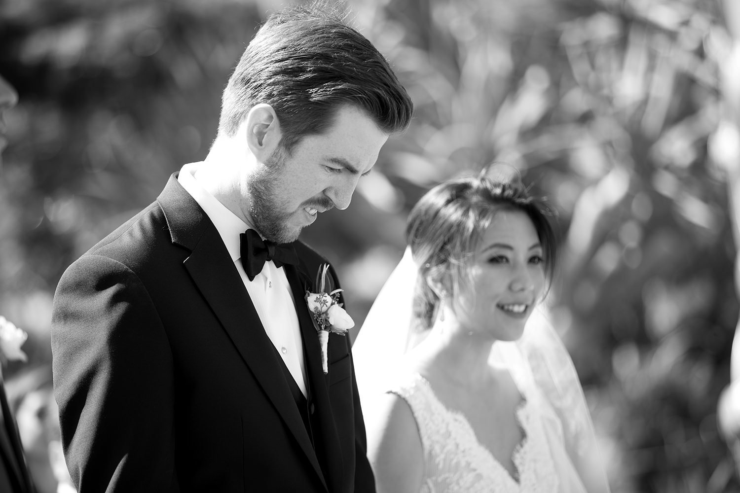 black and white image of bride and groom at ceremony