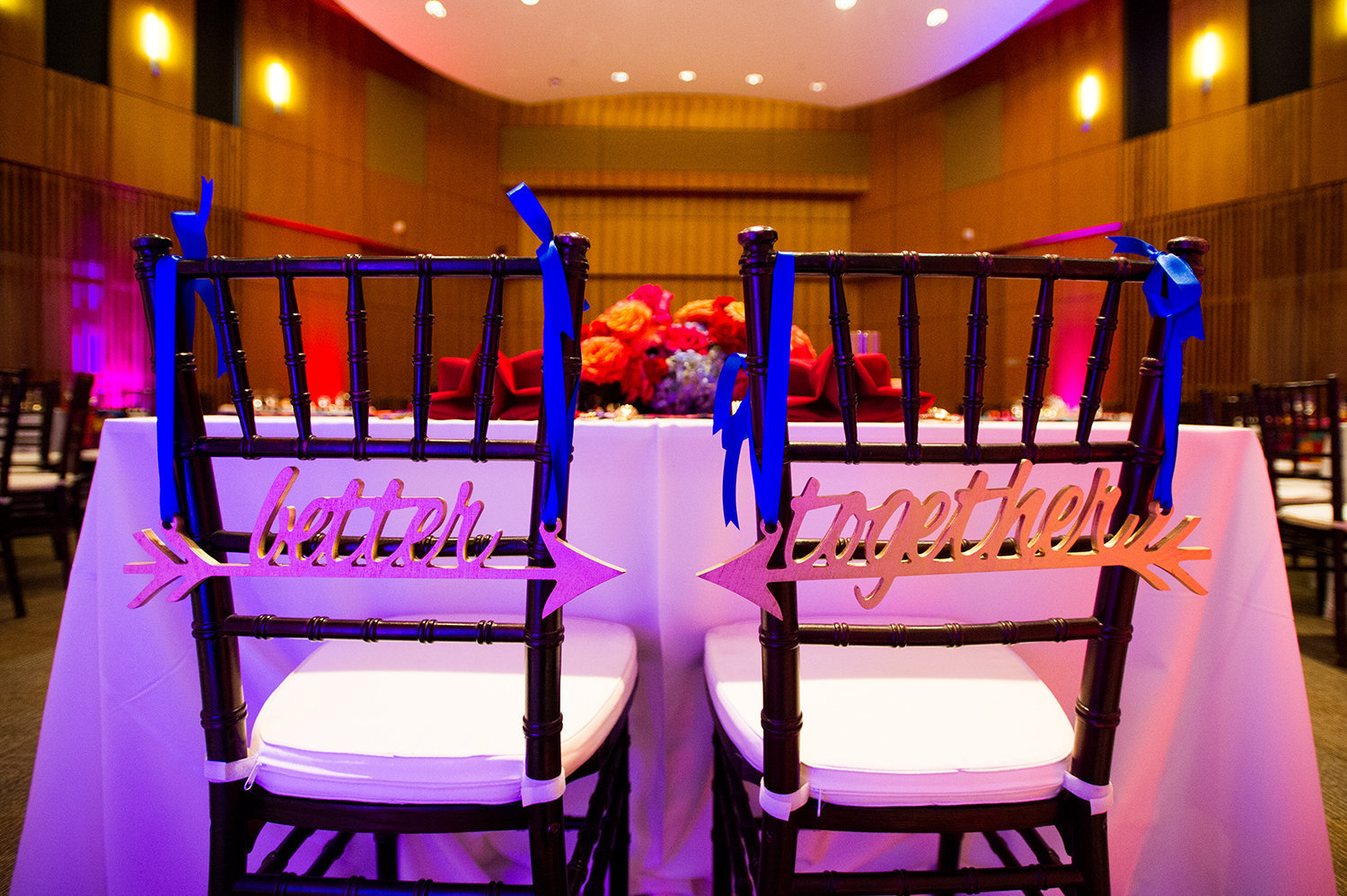 Cute chair signs for the bride and groom at an Indian wedding reception