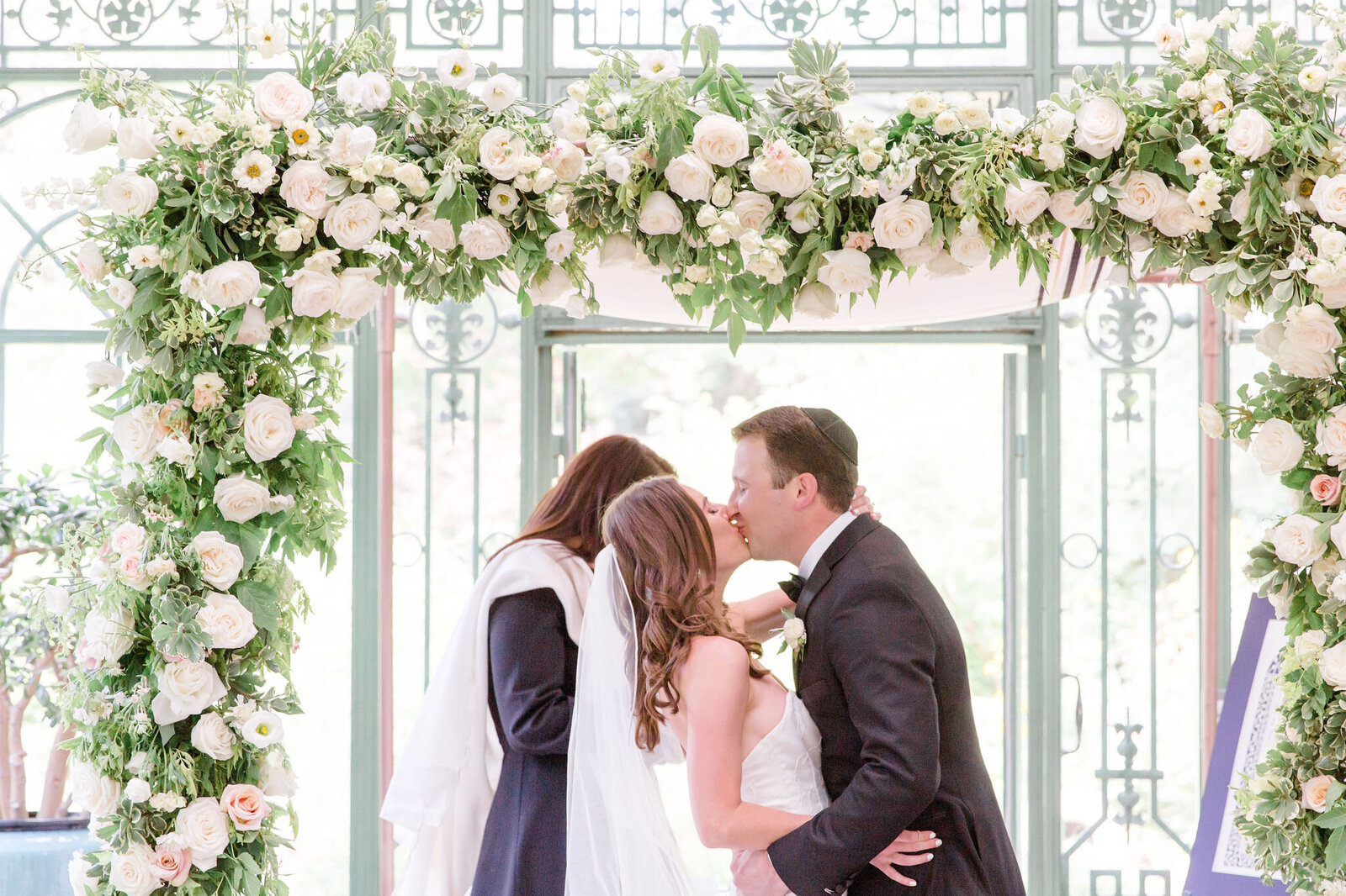 Altar structure covered in flowers, white and blush wedding flowers, garden wedding, just married, michele with one l, denver botanic gardens wedding