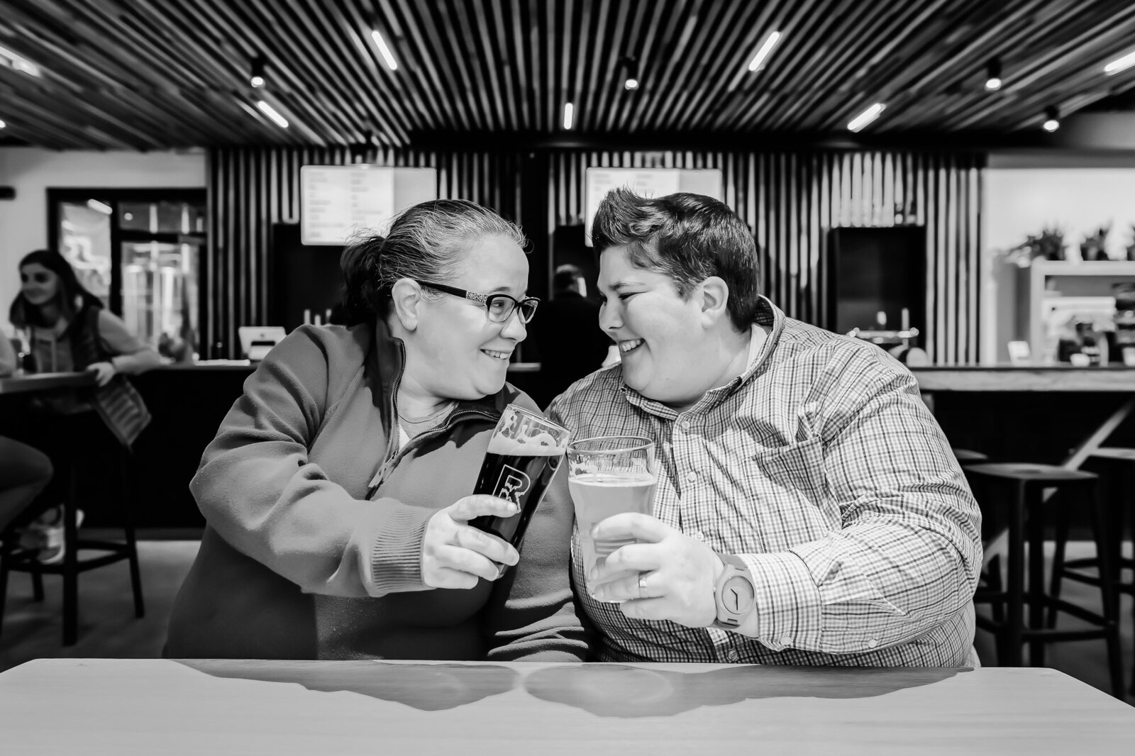 St. Louis Engagement photography with an LGBT couple drinking beer at Rockwell Brewing Co.