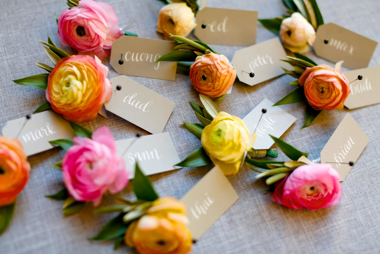 colorful pink orange yellow boutonnieres from everly alaine florals