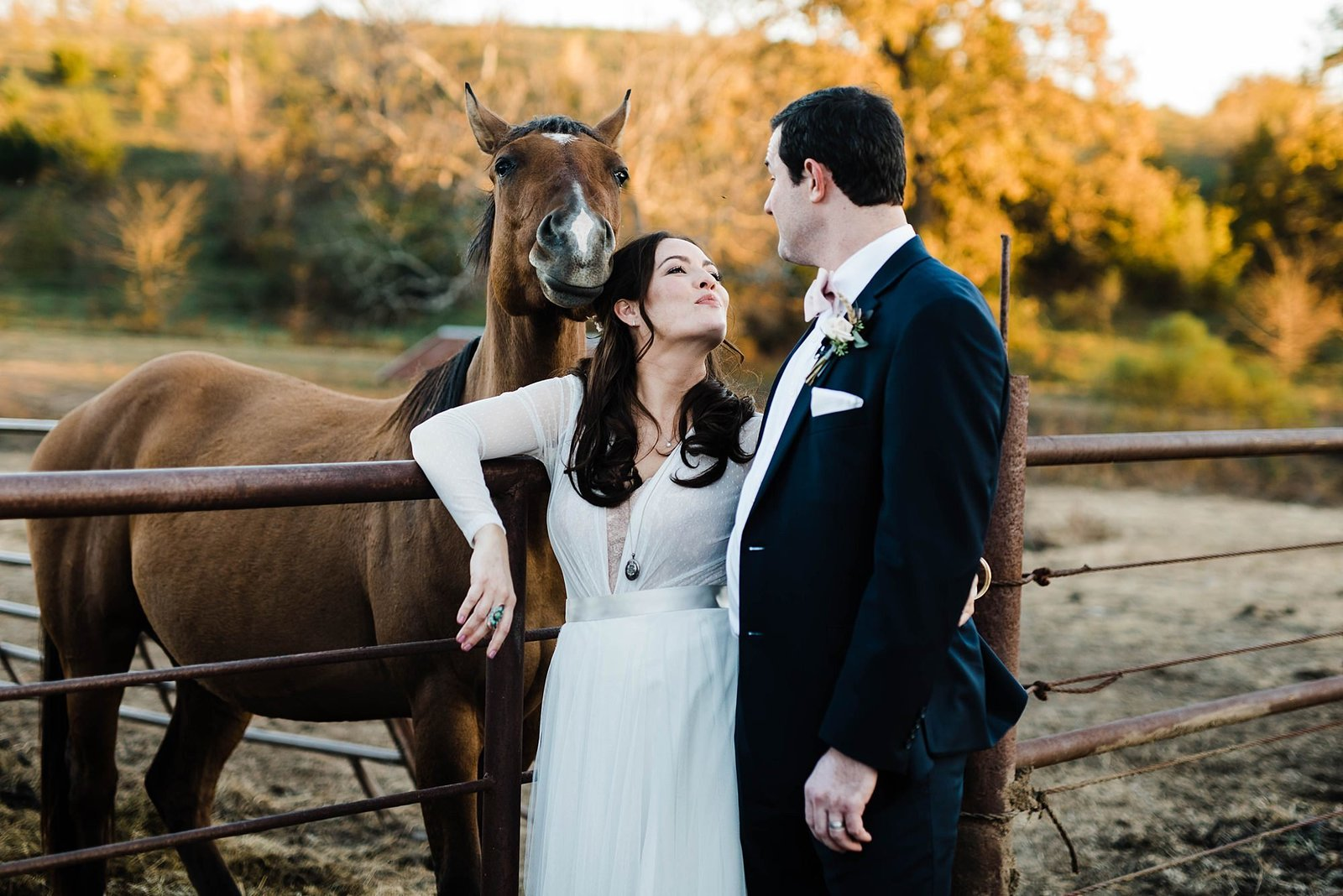 bride and groom kiss near horse at circle s ranch wedding