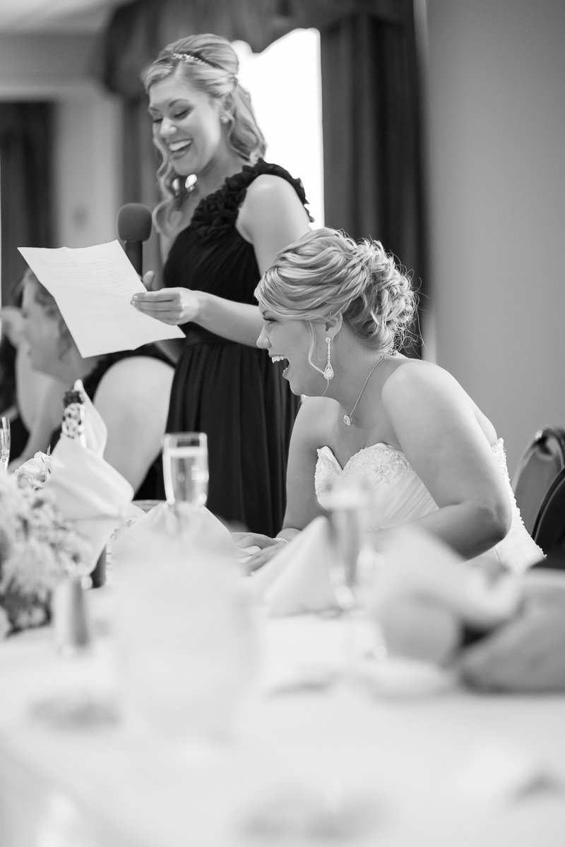 candid image at a wedding in maryland by husband and wife wedding photographers