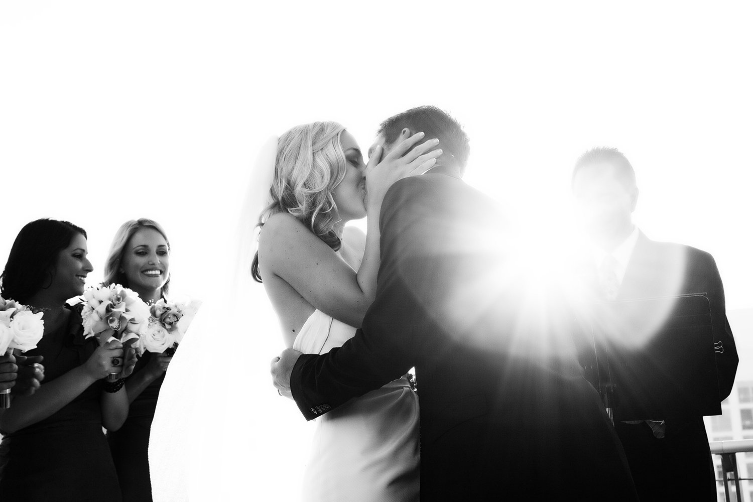 The Ultimate Skybox wedding photos bride and groom kiss at ceremony