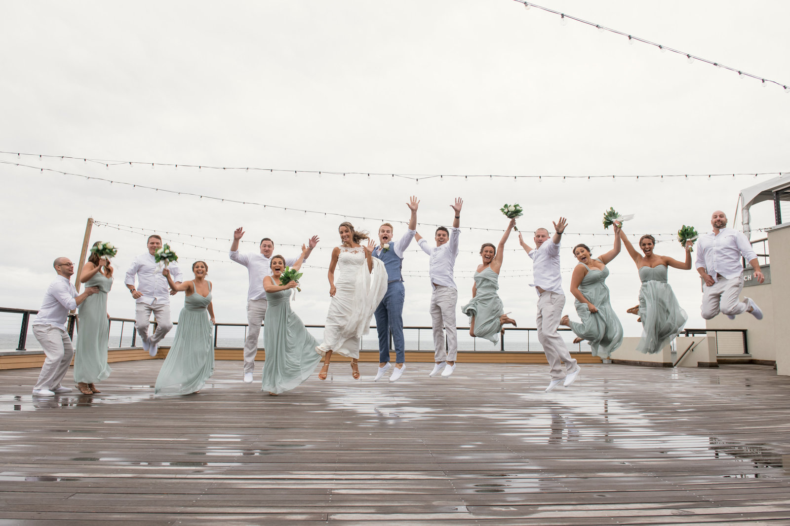 photo of bridal party jumping with bride and groom Gurneys Montauk Resort wedding