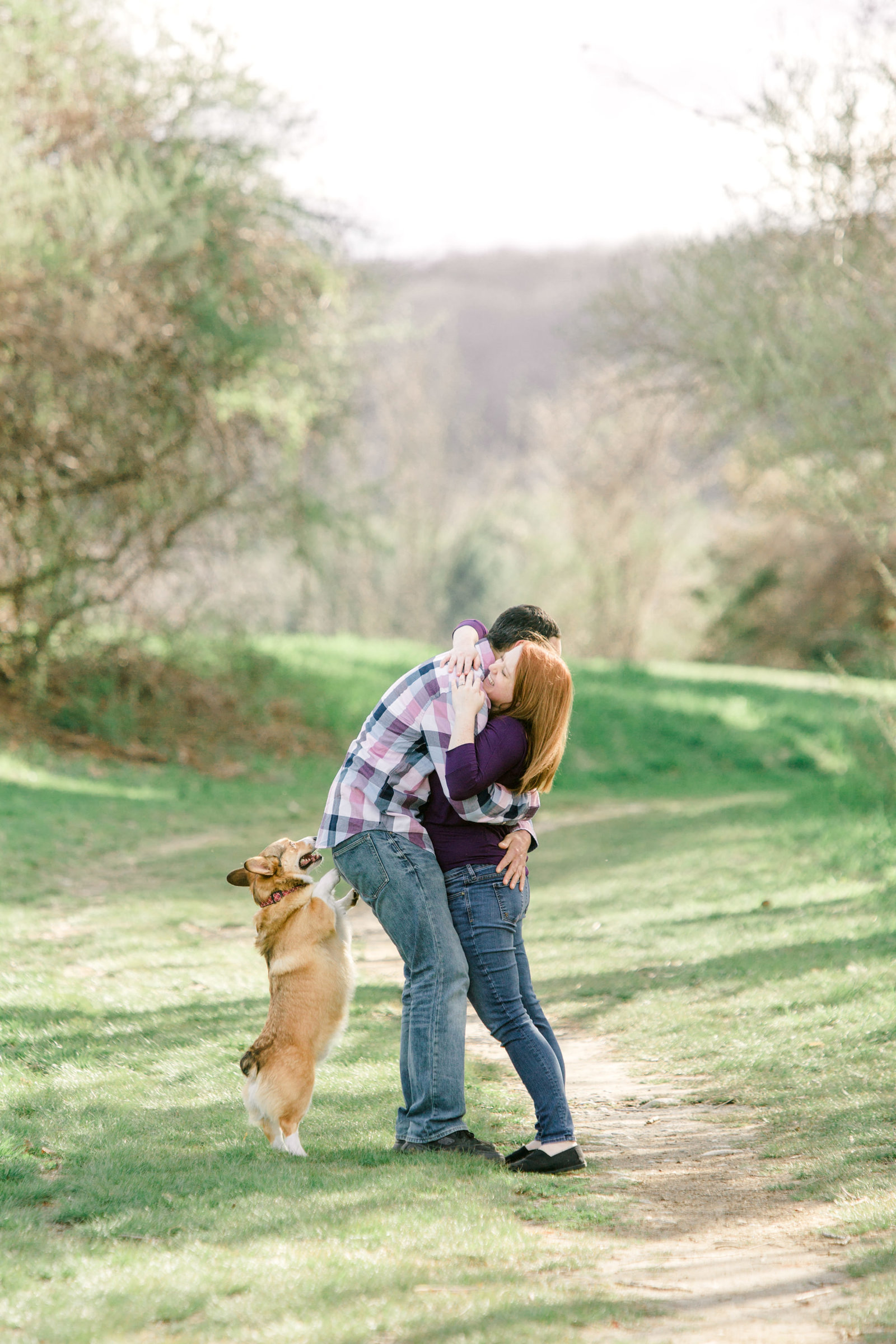 chase farm engagement photo with dogs