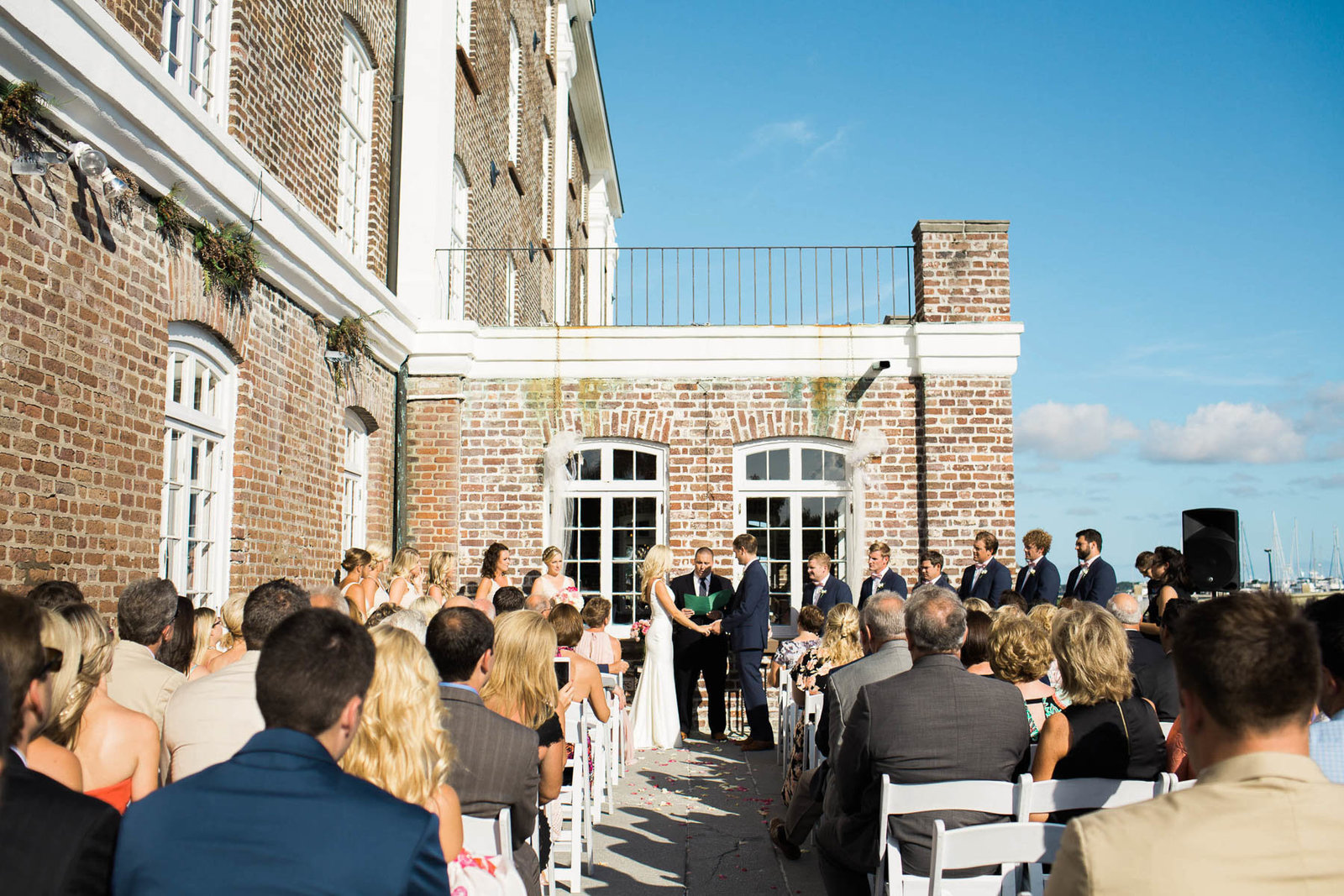 Bride and groom exchange vows, Rice Mill Building, Charleston, South Carolina