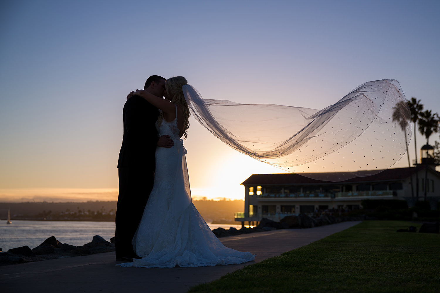 bride and groom with sunset beautiful veil