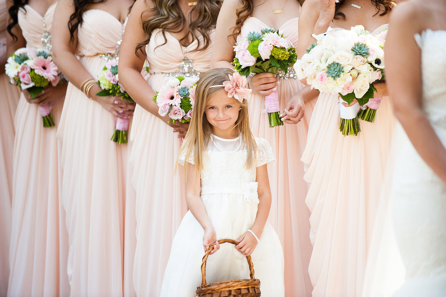 Sweet moment captured of the flower girl during the wedding ceremony