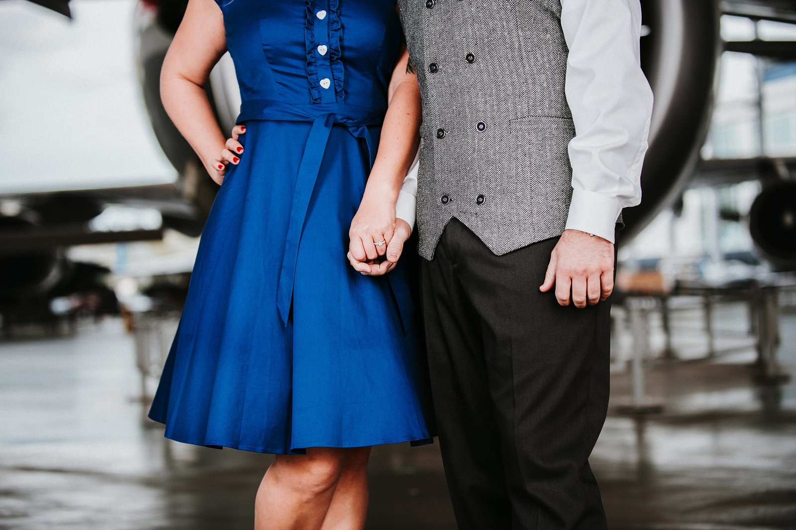 Couple holding hands in airplane  hanger Cle Elum Engagement Photographer
