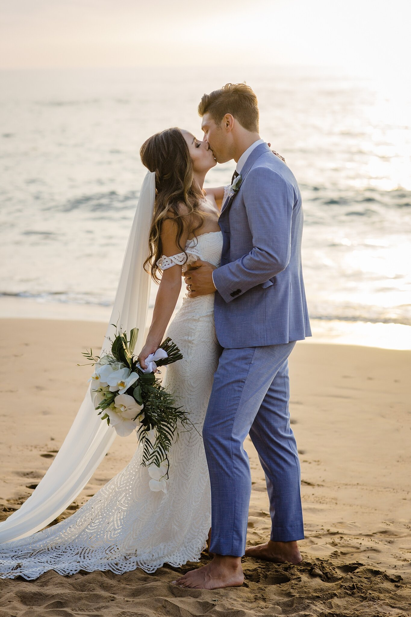 wedding kiss on the beach