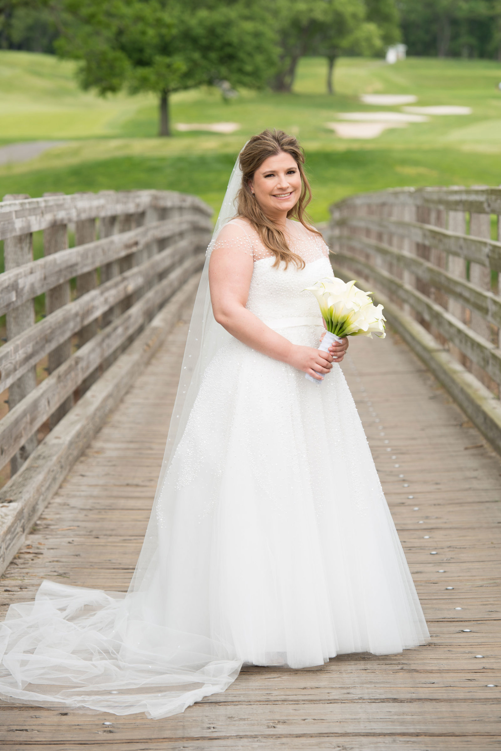 beautiful bride on the bridge at Engineers Country Club