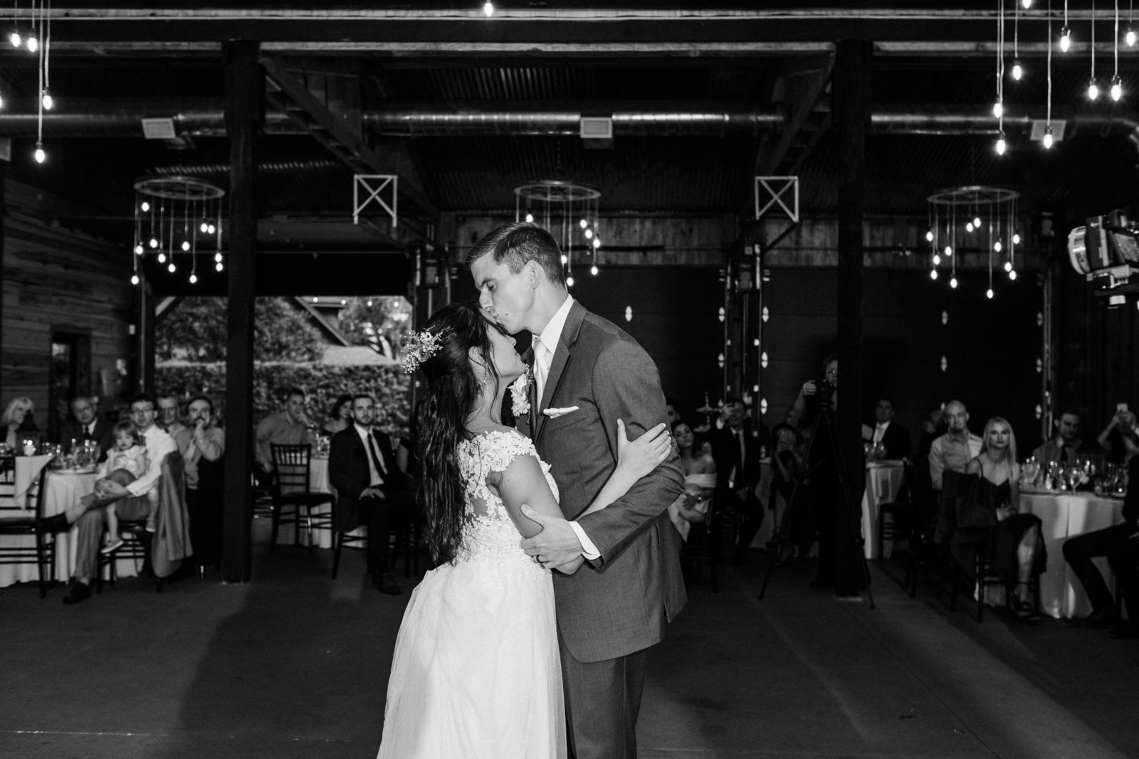 Couple intimately embrace during first dance at their wedding reception at Club Lake Plantation
