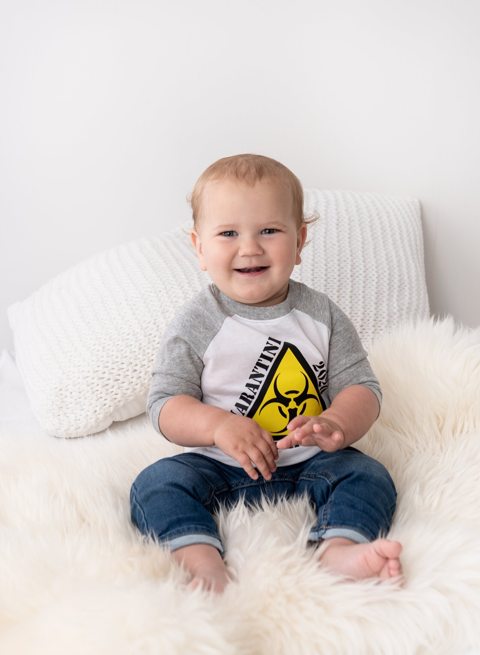 little boy smiling for camera and wearing a shirt that says quarantine birthday