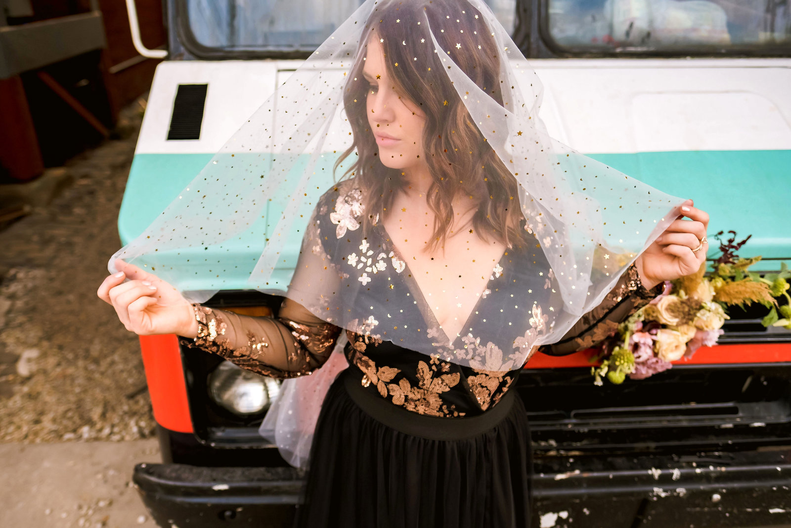 Photo of a Detroit  bride with a veil over her face in Eastern Market