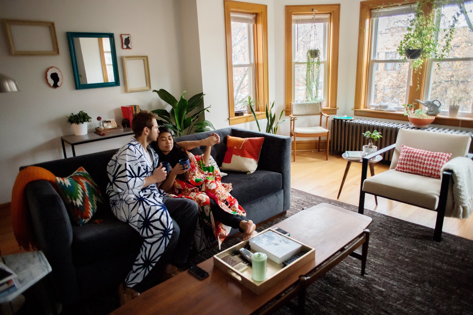a couple sit in their mid century living room in chicago